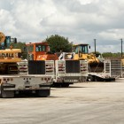 Vehicles carrying emergency equipment in preparation of response to costal floods gather at the San Antonio TxDOT office staging area.