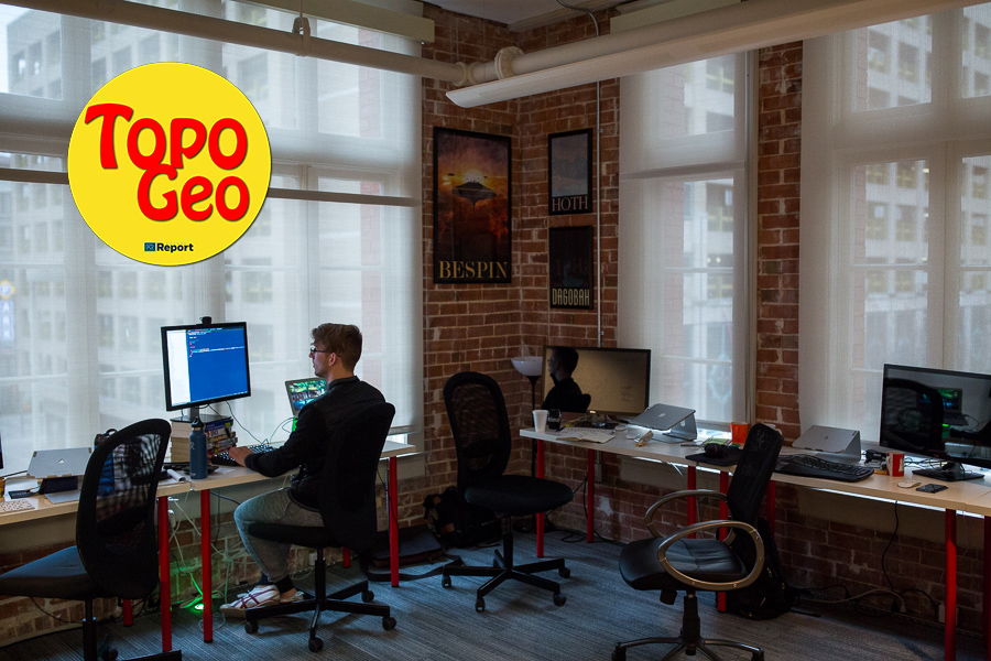 Grok Interactive Software Developer Jacob Ernst works at his desk.