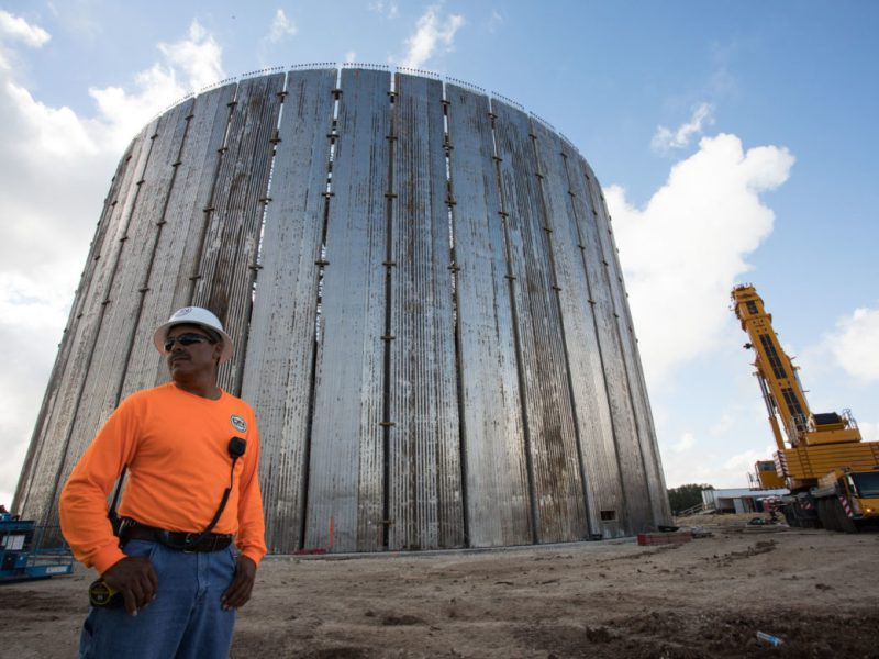 Roberto Gonzalez, DN Tanks Superintendent, stands in front of a ten-million gallon water storage tank, part of the San Antonio Water System's Agua Vista site. The site will be the end point of the Vista Ridge pipeline.
