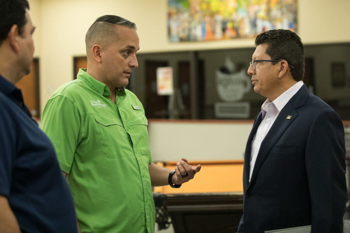 Councilman Greg Brockhouse (D6) (left) speaks with Richard Perez, San Antonio Chamber of Commerce CEO & President, before the meeting.