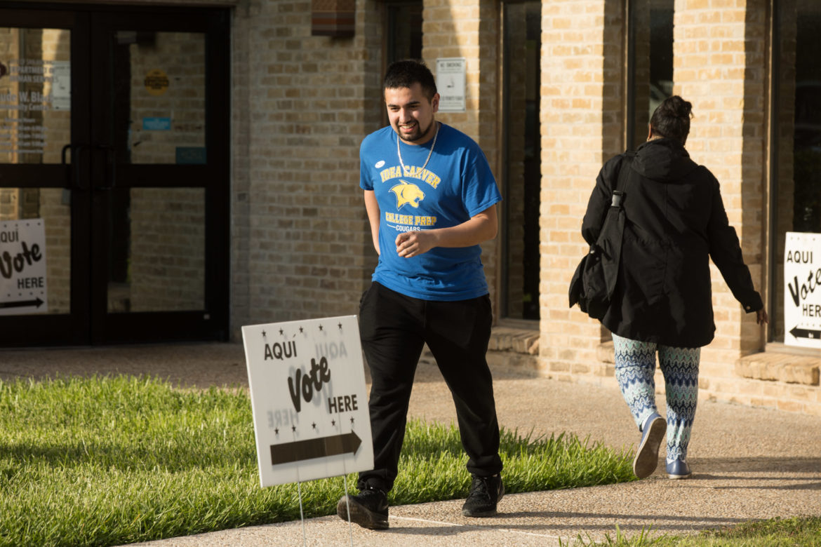 IDEA Carver senior Noah Martinez, 19, leaves the Claude Black Community Center polling site after voting for the first time.