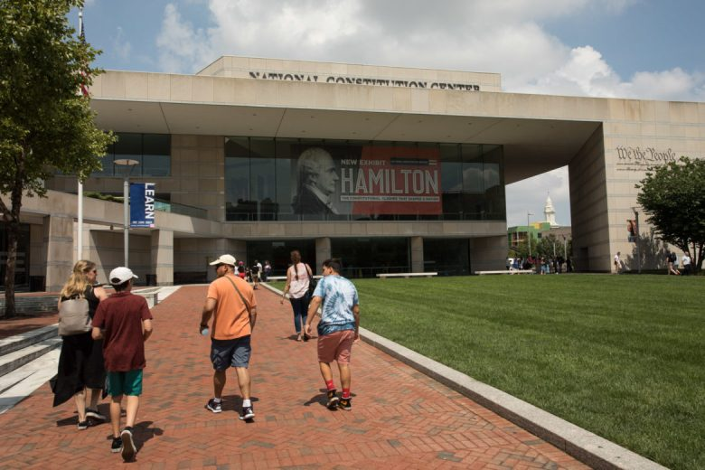 Tourists walk towards the National Constitution Center.
