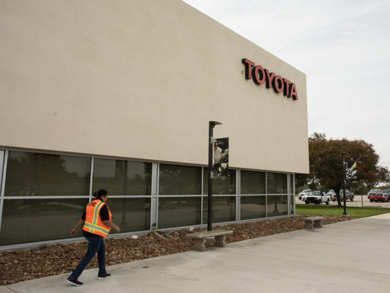 A woman walks out of the Toyota Motor Manufacturing Texas Visitor Center.