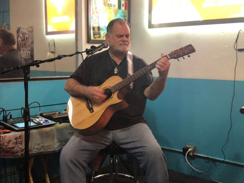 Guitarist and singer Bill Middleton plays a Neil Peterson guitar custom made from recycled piano wood, at Goofy's Bar and Grill in Canyon Lake.
