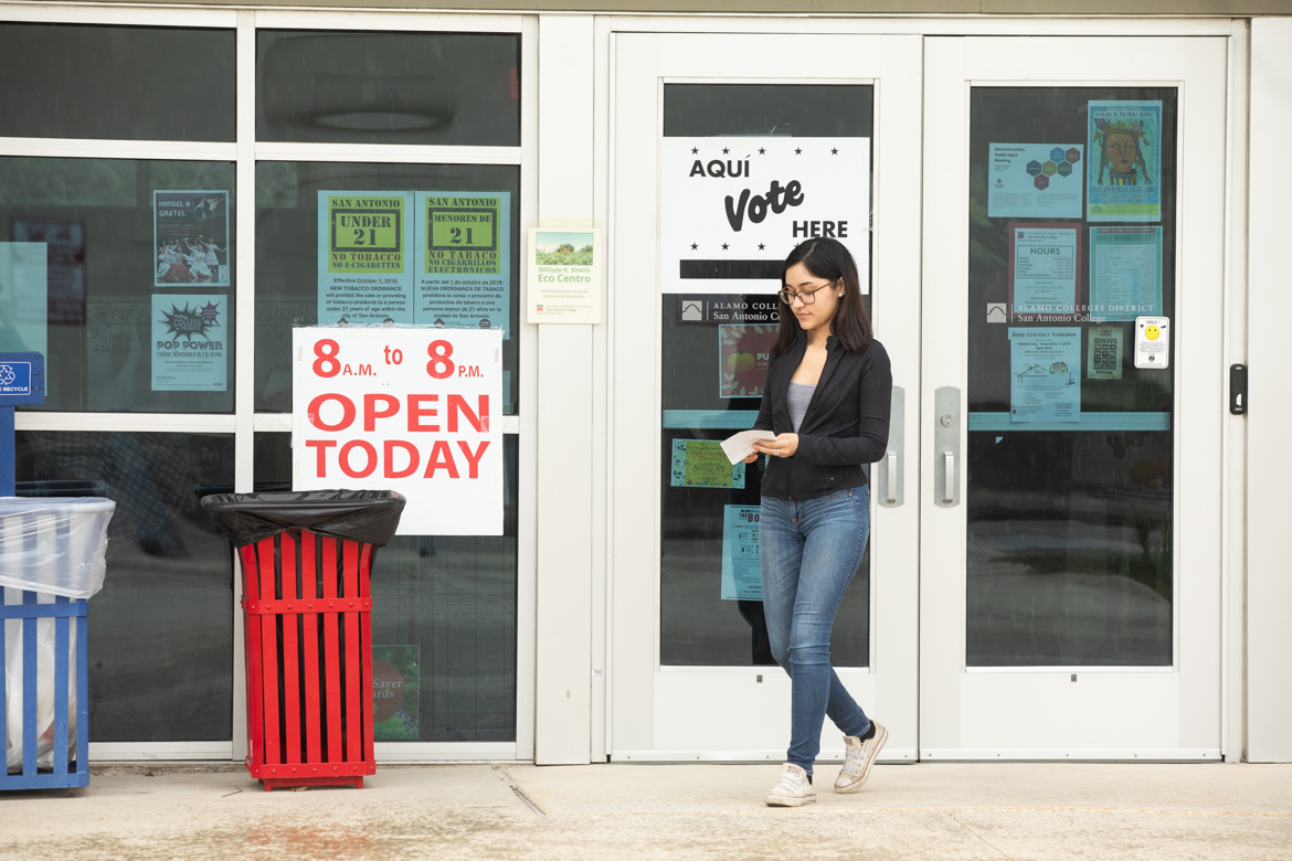 Travis Early College High School senior Brenda Gomez exits the William R. Sinkin Eco Centro after voting for the first time.