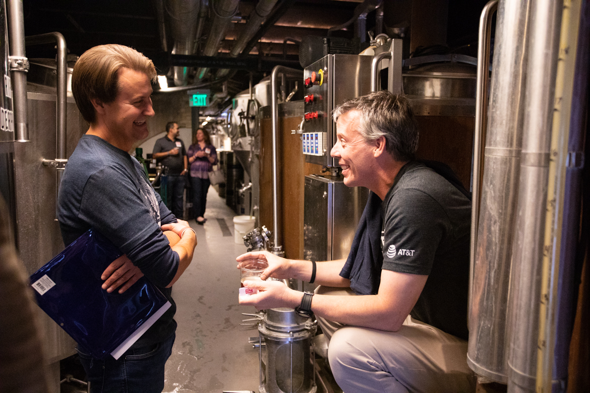 (From left) Tech Bloc CEO David Heard and Scaleworks General Partner Lew Moorman chat in the brewery before the event.