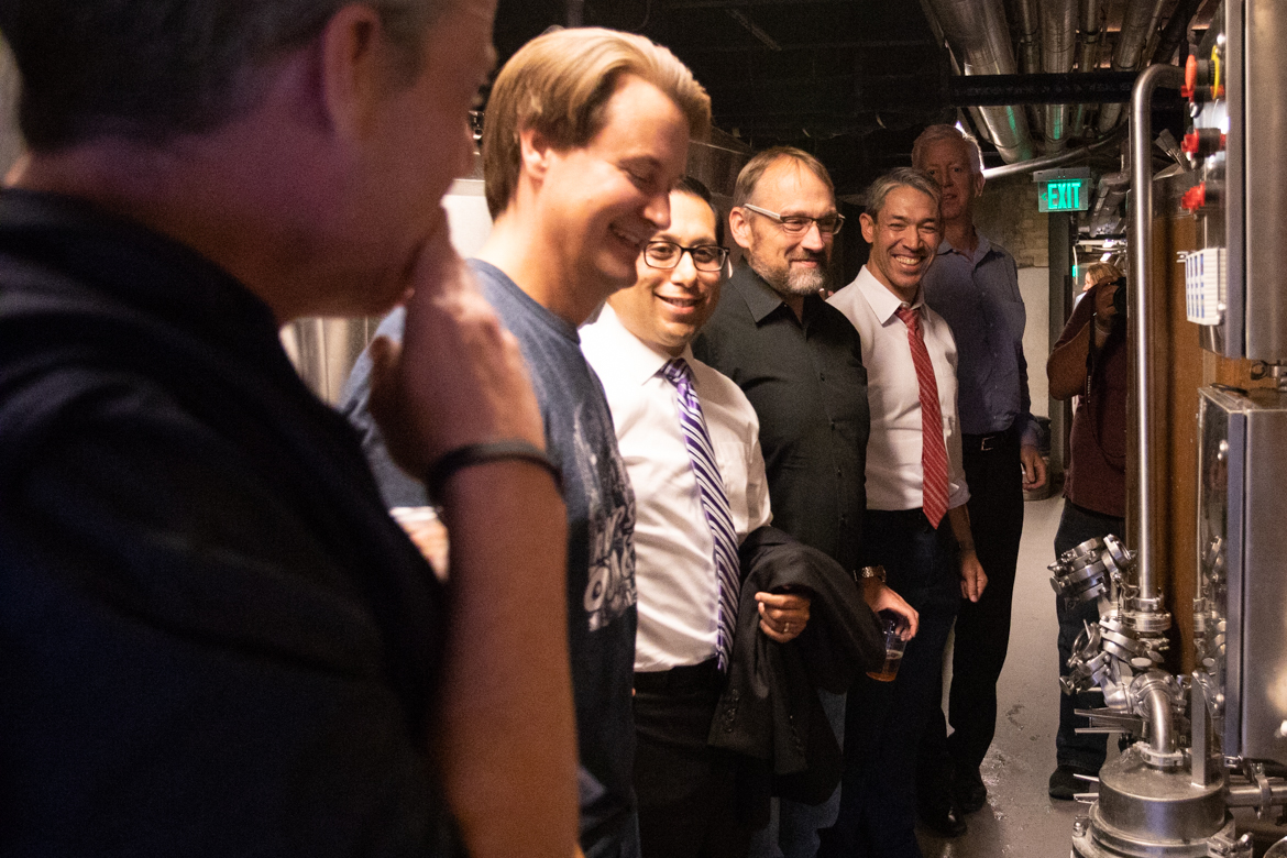 (From left) Scaleworks General Partner Lew Moorman, Tech Bloc CEO David Heard, State Rep. Diego Bernal (D-San Antonio), Go Vote No Campaign Manager Christian Archer, and Mayor Ron Nirenberg wait to speak on the second floor brewery in Southerleigh Fine Food and Brewery.