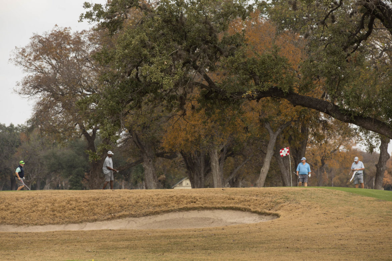 Golfers participate in a game at Historic Brackenridge Park Golf Course.