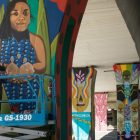 Suzy Gonzalez paints a mural under I-35 as part of the San Antonio Street Art Initiative.