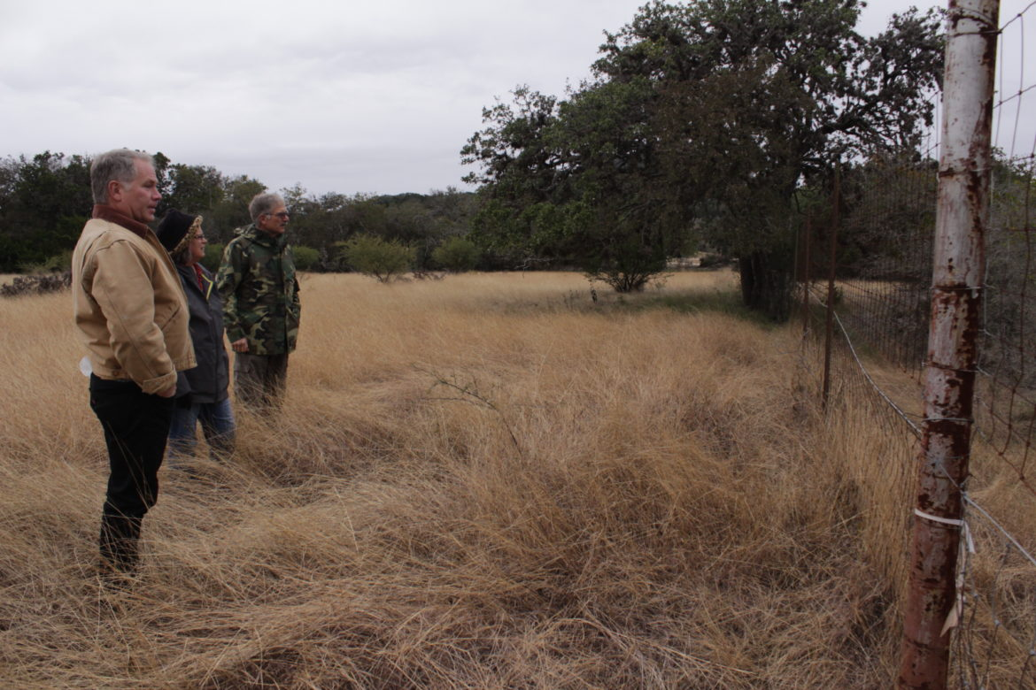 From left, John Blackwell, Margo Denke Griffin, and Charles Blackwell look across their property line at a dam built by their neighbors as part of a planned Christian youth camp.