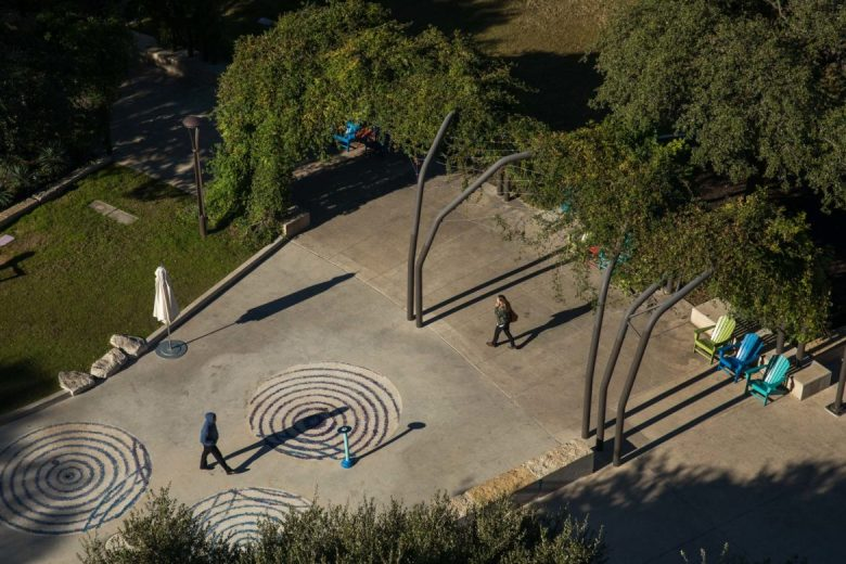 Hemisfair visitors walk through Yanaguana Garden which is directly adjacent to The '68.