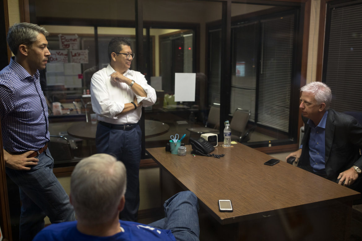 Mayor Ron Nirenberg (left) meets with San Antonio Chamber of Commerce President Richard Perez (center) and business leader Gordon Hartman (right) as voting results continue to come in.