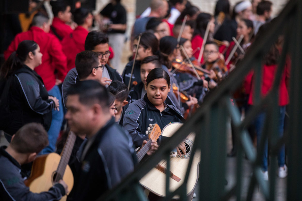Mariachi players practice before competition during Serenata en el Rio at the Shops at Rivercenter.