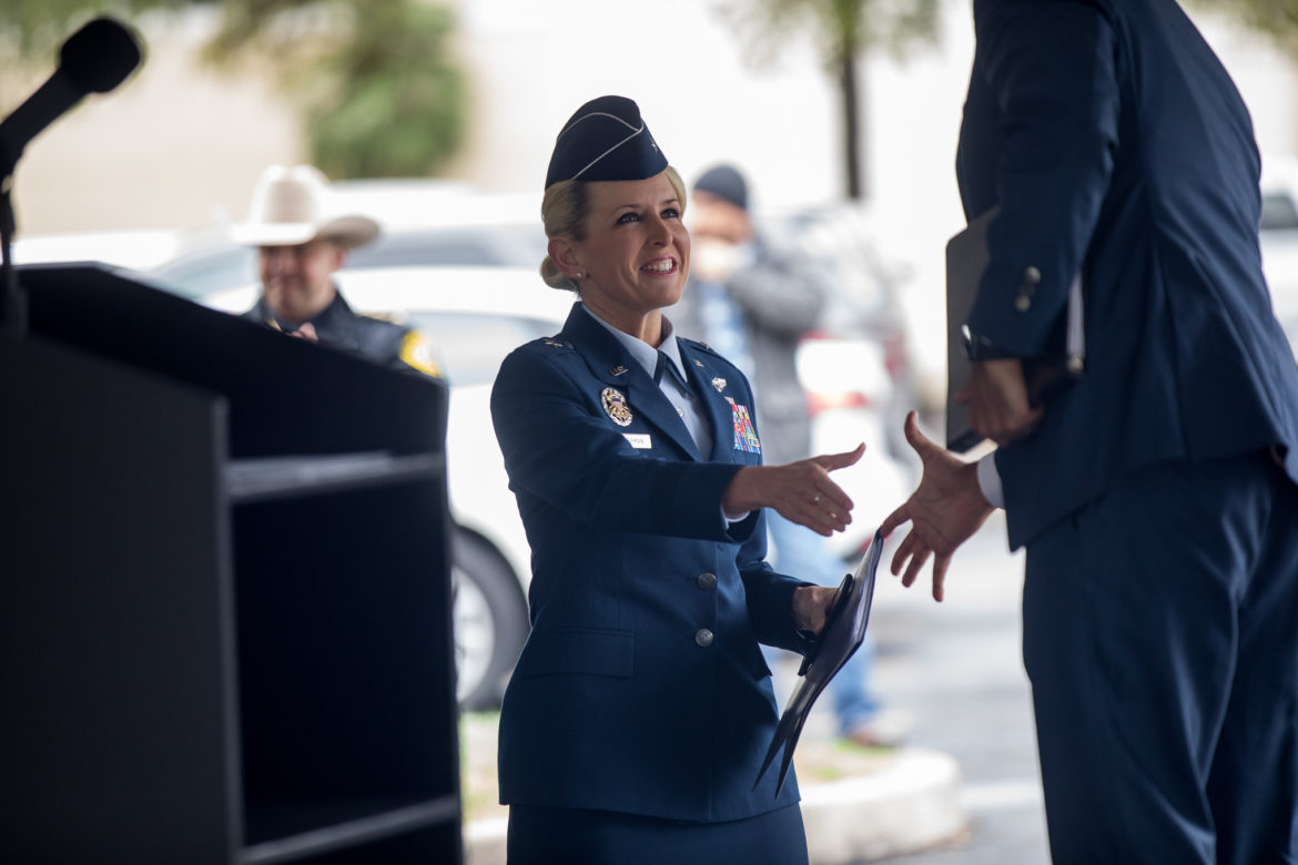 Joint Base San Antonio Commander Brig. Gen. Laura Lenderman approaches the stage after being introduce by Texas Land Commissioner George P. Bush.