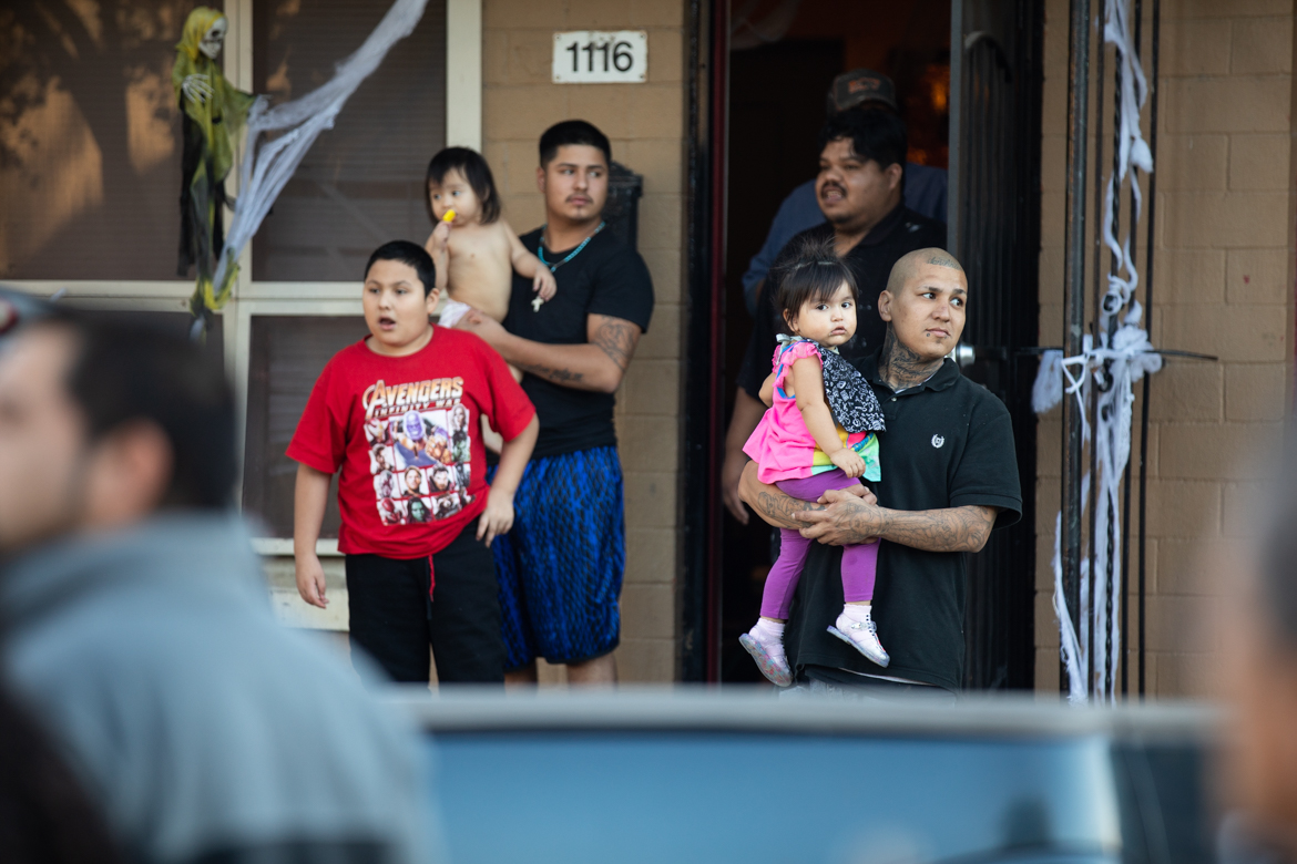 Residents of Alazan-Apache Courts watch the procession.