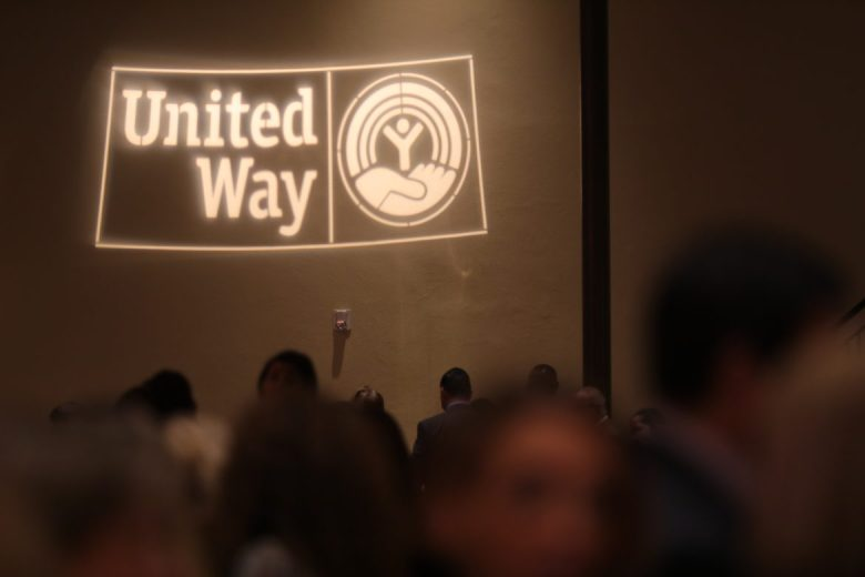 The United Way logo projected onto a wall