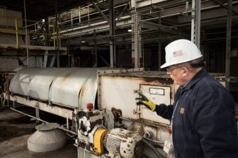 Benny Ethridge, CPS Energy Senior Vice President of Power Generation, walks past a conveyor belt that moved coal through the Deely plant.