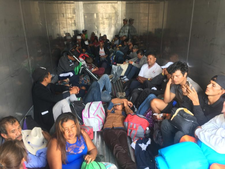 Migrants travel in a refrigerated truck headed toward Santiago de Querétaro on Nov. 9, 2018.