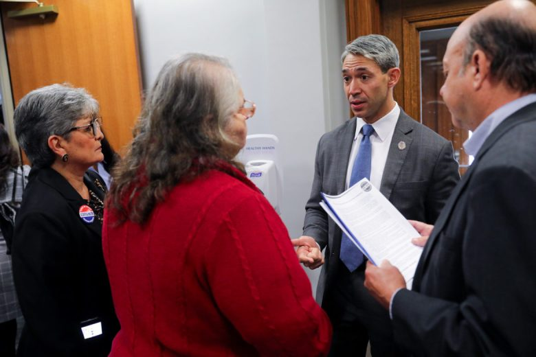 Mayor Ron Nirenberg speaks with leaders of Cops / Metro prior to City Council B Session discussing CCHIP.