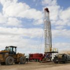 A derrick will be used to run steel drilling pipe into the well and fill with material such as gravel and mud.
