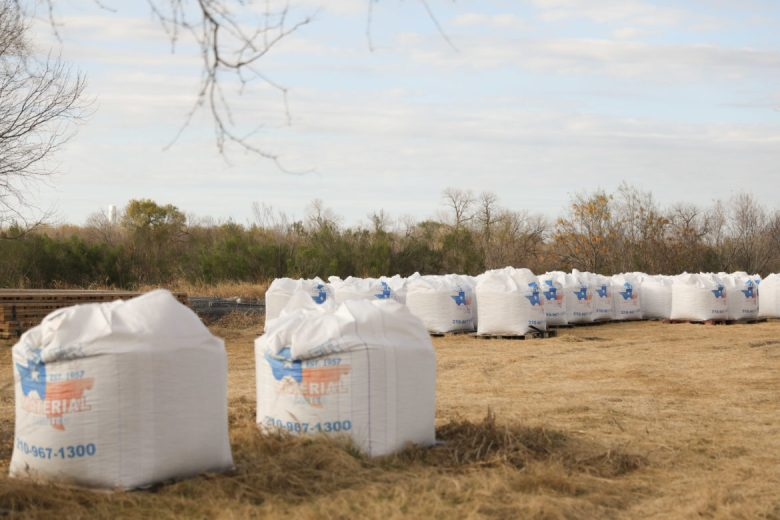 Thousands upon thousands of bags of gravel sit waiting to be utilized in the plugging of the catfish farm well.