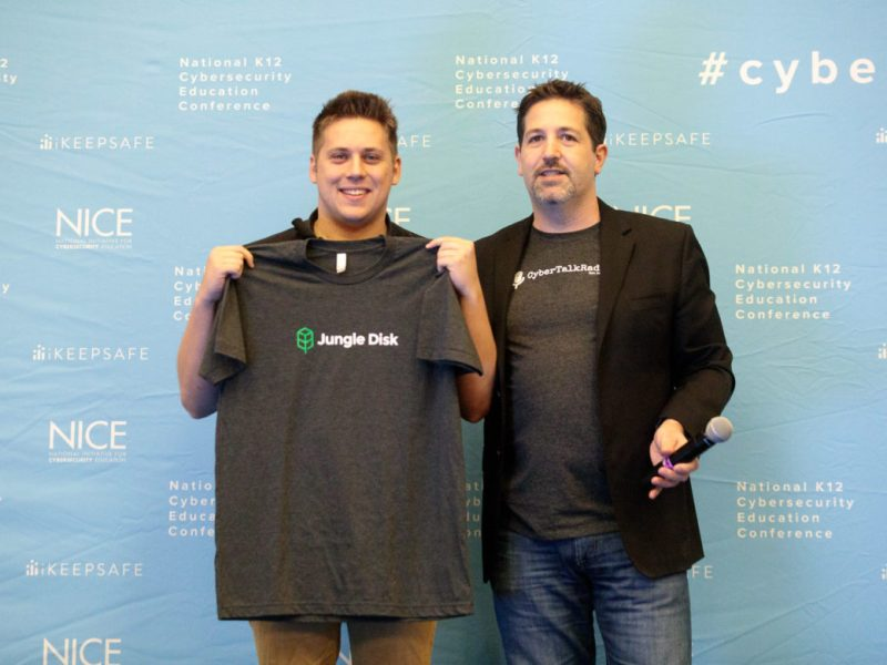 Jungle Disk CEO Bret Piatt (right) poses with Christian (left) who has decided to join Jungle Disk during Cyber Signing Day.