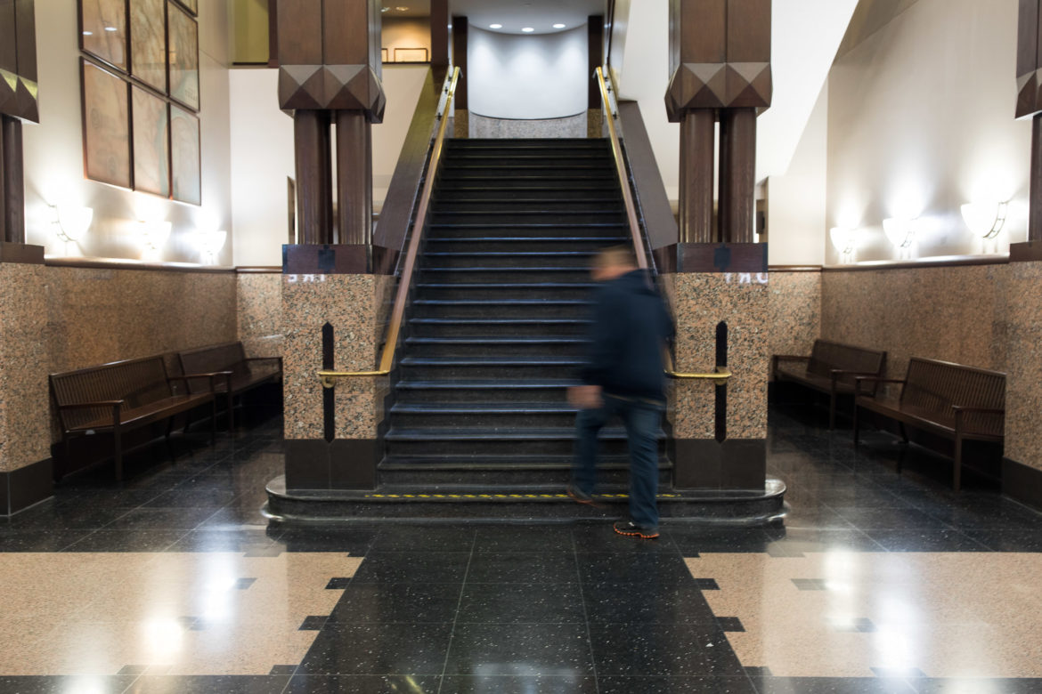 The staircase to the second floor of the Bexar County Justice Center.