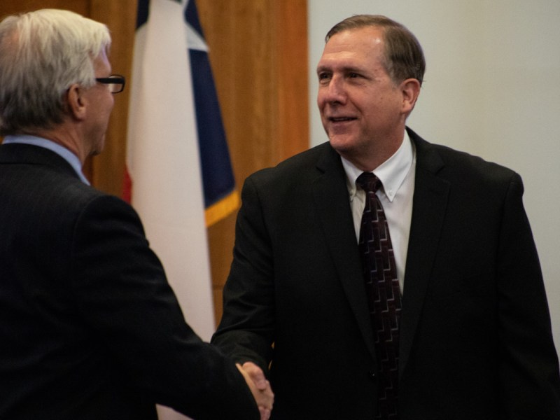 Alamo Heights Mayor Bobby Rosenthal (left) shakes the hand of Alamo Heights City Manager Mark Browne, who is leaving San Antonio for Schertz.