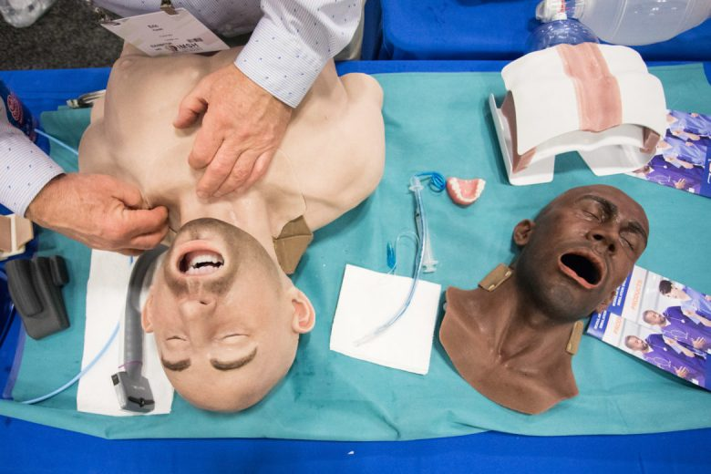 Eric Ferski, 7-SIGMA Simulation Systems product manager, assembles the face of a patient simulator.