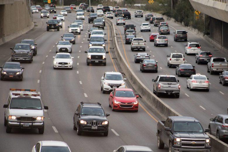 Cars travel along U.S. Highway 281 near the bridge on Stadium Drive at rush hour.