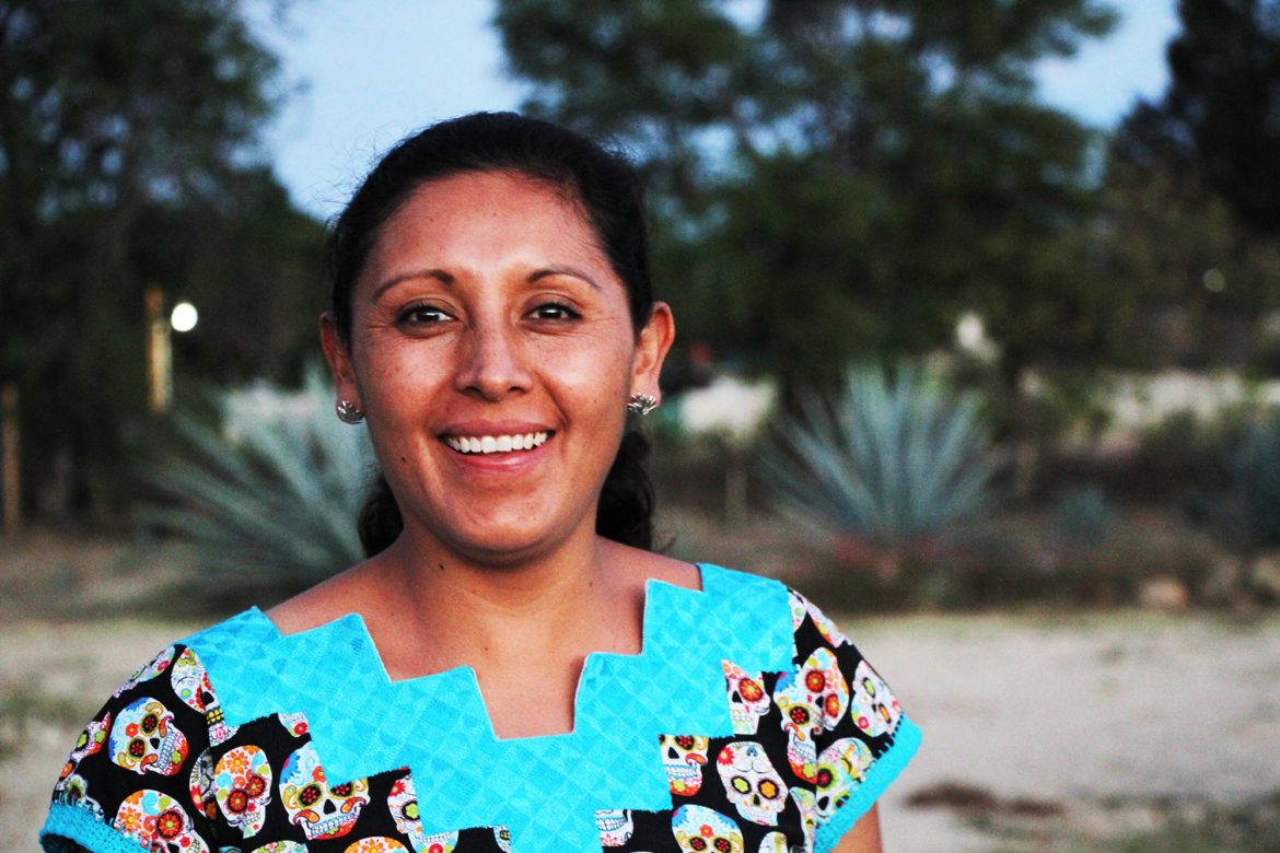 A portrait of Graciela Angeles Carreño in front of the agave or maguey plant.