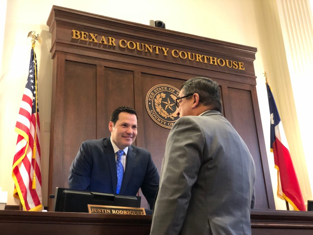 Justin Rodriguez meets with County staff in front of his new seat.