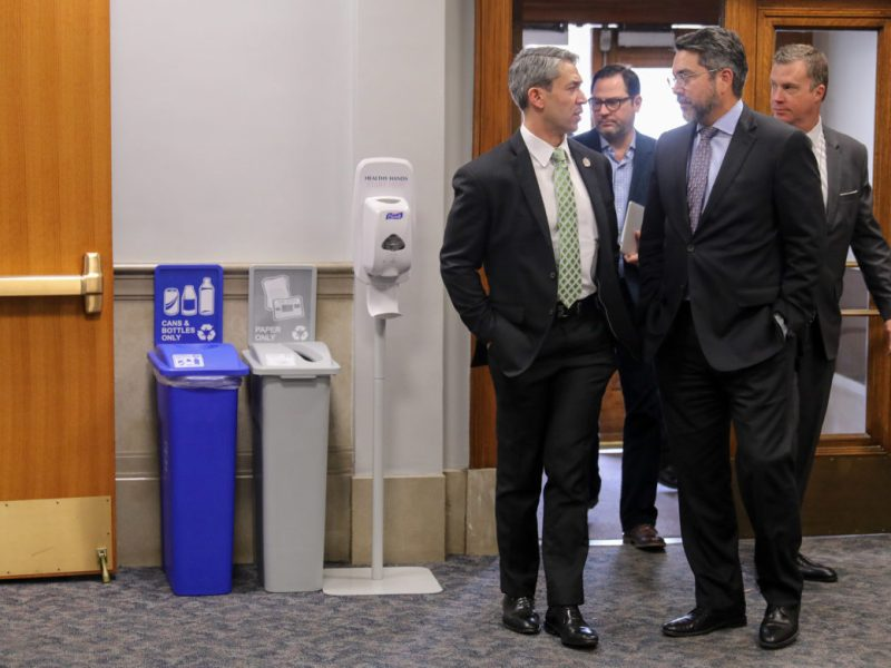 Mayor Ron Nirenberg (left) speaks with Councilman Roberto Treviño (D1) before a council session in January.