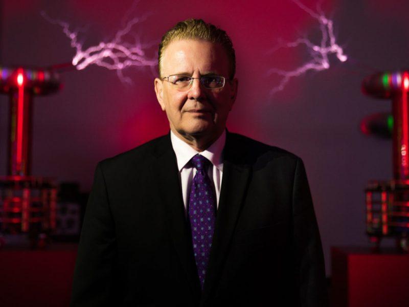 David Monroe in front of tesla coils.