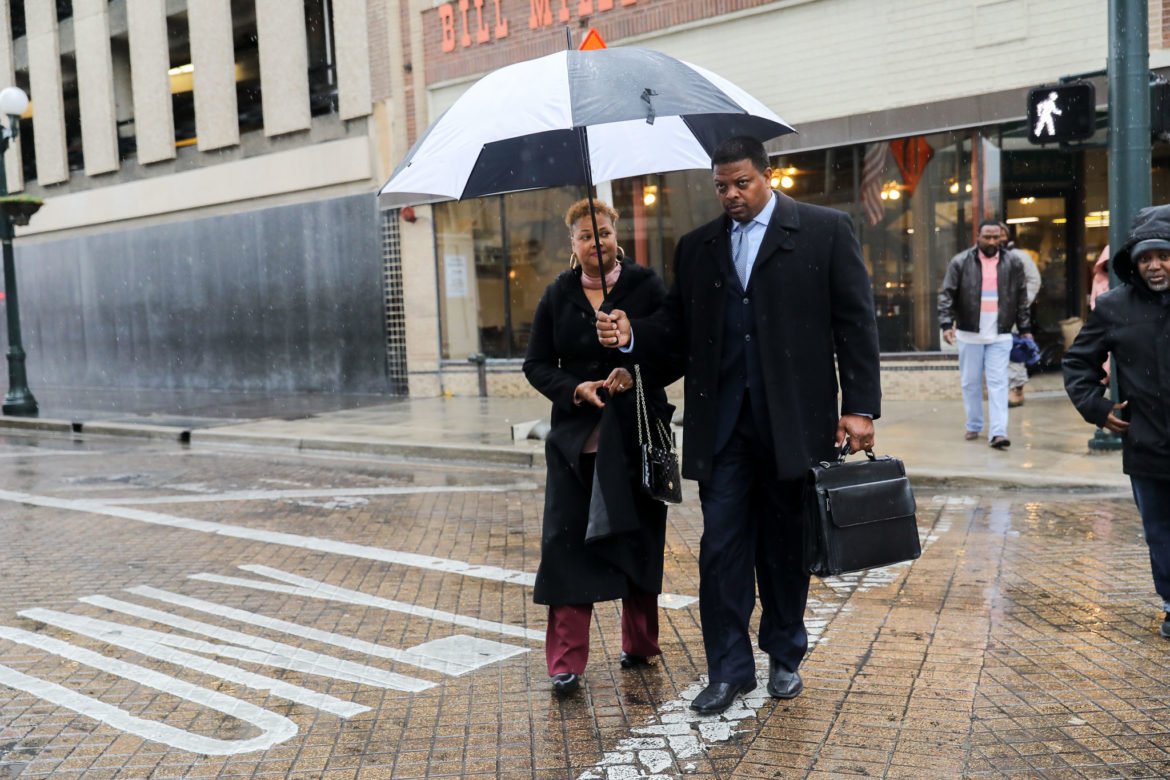Dereck Hillyer and his wife of 34 years, Vivian, walk to file his paperwork declaring candidacy for City Council District 2.
