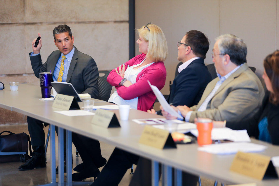 Mike Villarreal presents his findings to the Early Childhood Education Municipal Development Corporation board.