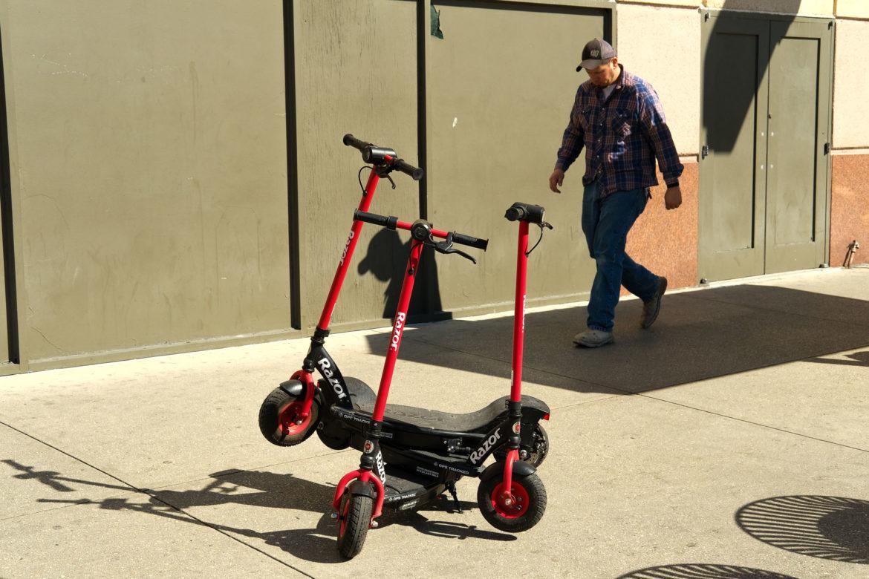 Razor scooters in downtown San Antonio along Commerce Street.