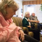 Residents practice deep breathing exercises during their stretching activity.