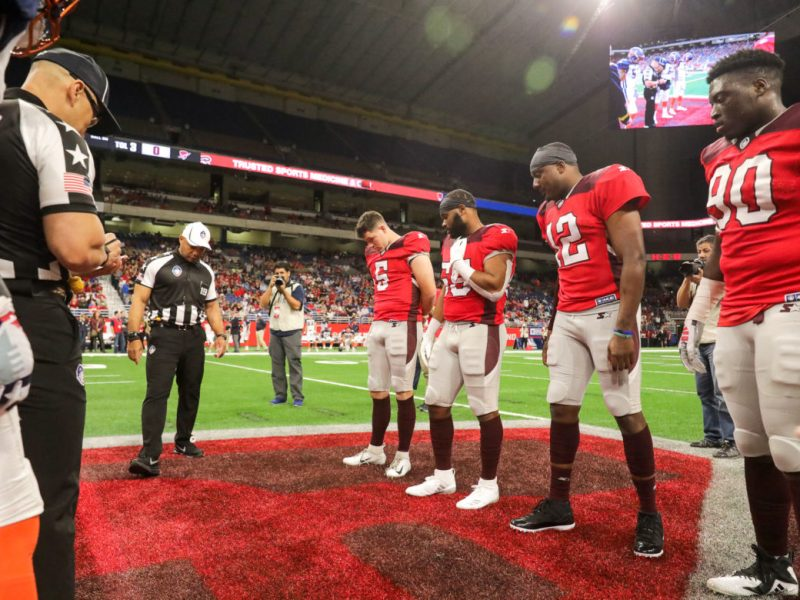 San Antonio Commanders players watch the coin toss prior to a February 17, 2019 game against the Orlando Apollos.