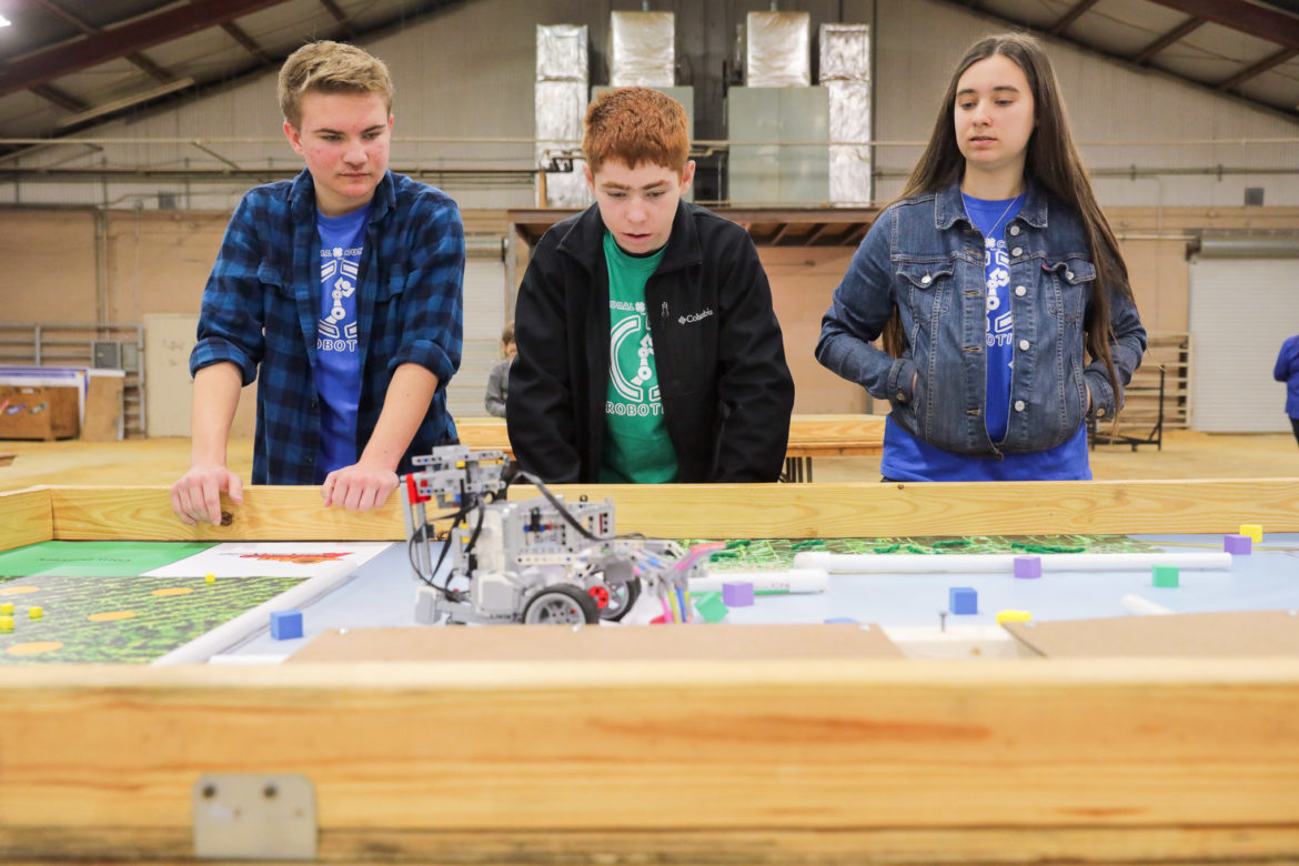 A participating robotics team test their latest iteration in the Agrobotics challenge during the San Antonio Rodeo.