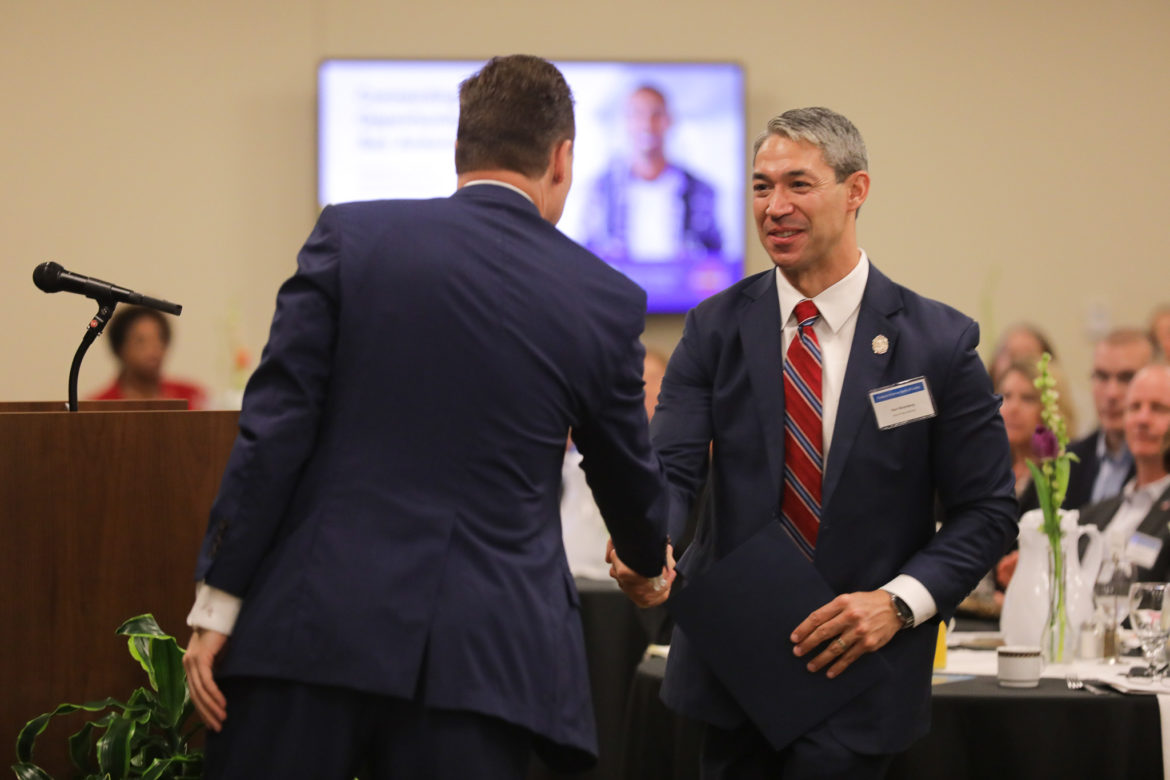 Mayor Ron Nirenberg shakes hands with Blake Hastings during Connecting Youth to Opportunity in San Antonio.