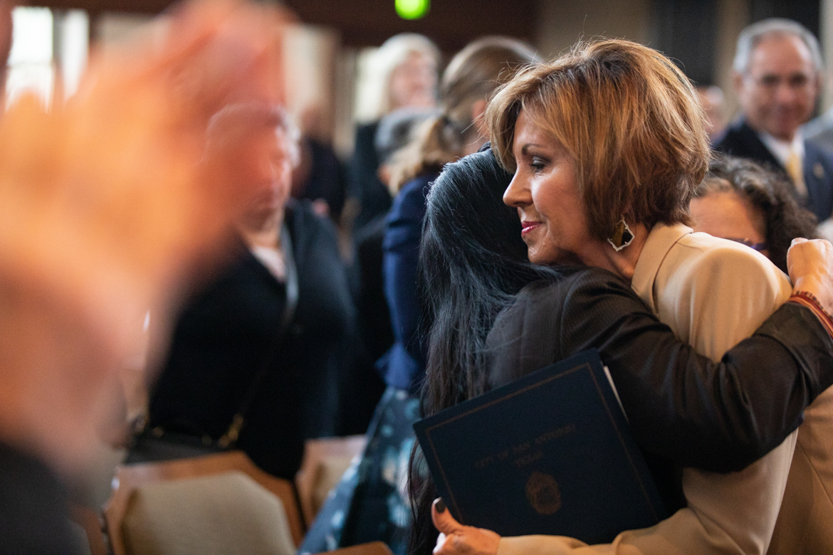 Outgoing City Manager Sheryl Sculley (right) greets friends and family after giving a speech.