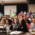 A large crowd fills the room on Monday evening.