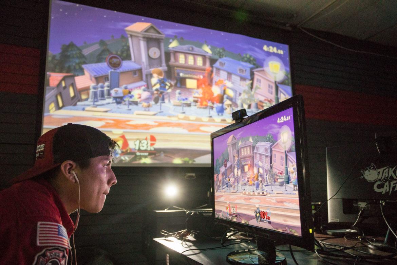 "Joseph ""Beatbox Joe"" Munera plays Super Smash Bros. on the Twitch screen."