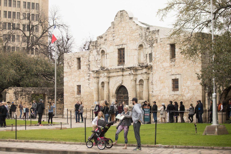 Tourists in Alamo Plaza.
