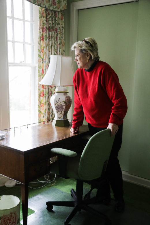 Taddy McAllister stands by the window of her childhood bedroom.