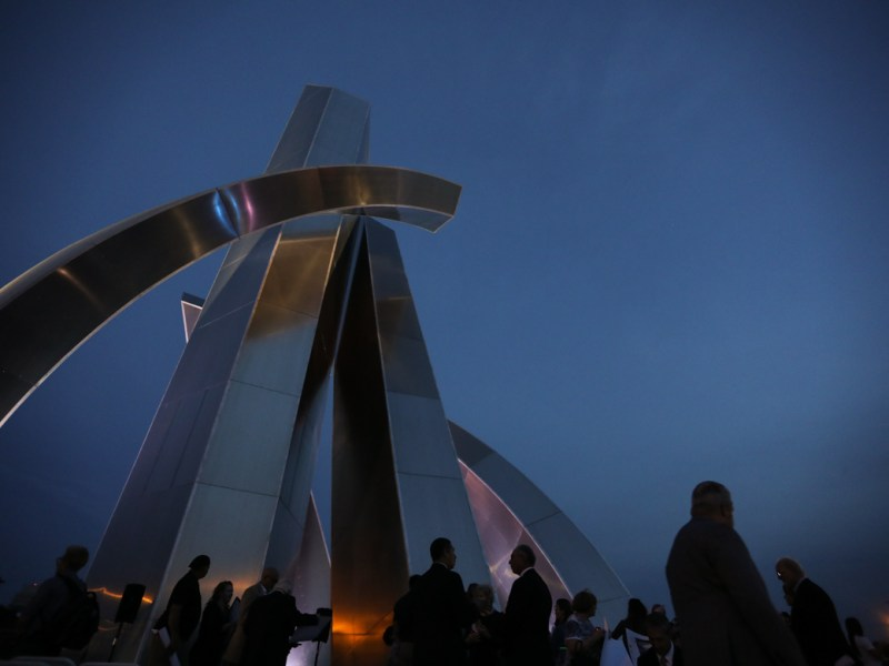 The Tribute to Freedom monument is lit up for the first time.