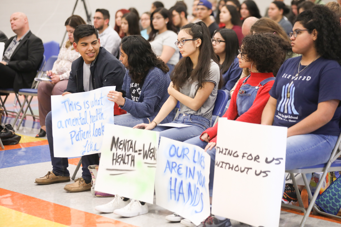 South San Antonio High School students attend a school board meeting with signs to bring awareness to mental health issues.