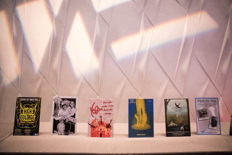 Posters for each documentary film line the lobby of the Tobin Center for the Performing Arts.