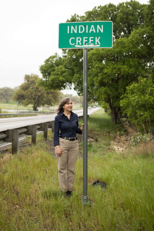 Michelle Molina, a Bulverde resident leading Bulverde Neighborhoods For Clean Water, stands next to Indian Creek.